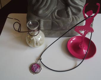 Black waxed cord and paint effect resin cabochon pendant necklace rose on engraved silver metal support.