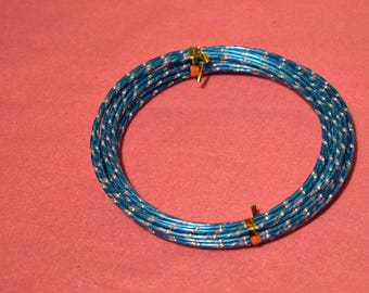 Teal and grey striped aluminum wire