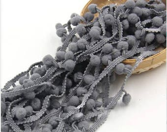 One meter of trim tassel color: gray