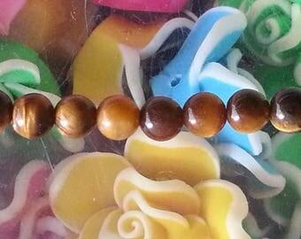 1 4mm in diameter, hole 1 mm Tiger eye beads