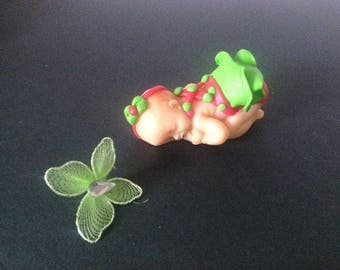 polymer clay with a green dress baby