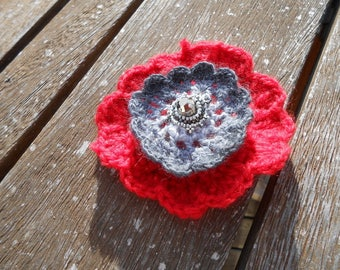 Weaving and red and grey crochet flower brooch