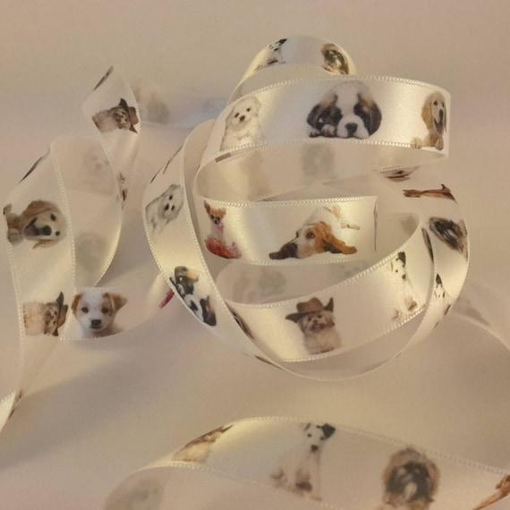 Dog motif on white satin ribbon