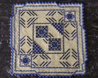 Square doily embroidered in Hardanger yellow and blue