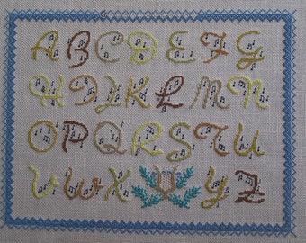A musical alphabet cross stitch Embroidery