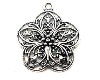 silver colored metal flower charm