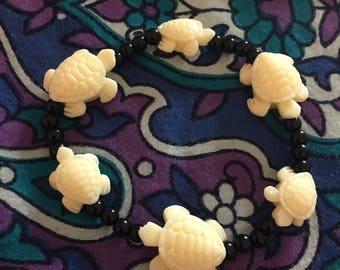 Cream turtle bracelet with black beads