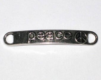 "A 3.8 cm silver metal ""Peace"" connector"