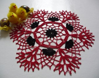Handmade red and black cotton crochet lace doily.