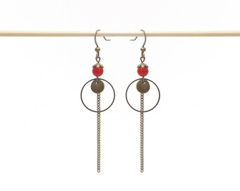 Earrings pendants, chains and red beads