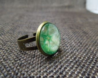 Shades of green and glass cabochon ring