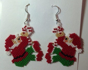 Christmas, my creation is handmade earrings woven Santa payote