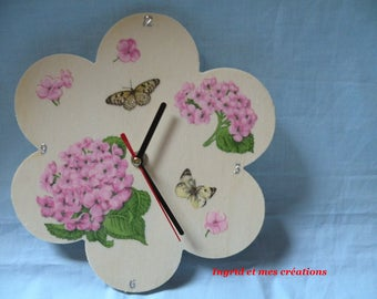 Decorated with hydrangeas wooden clock