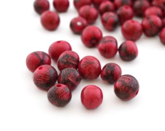 10 raspberry red round beads in 6-10mm Acai seeds