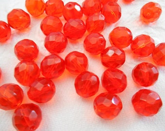A set of six beads 12 mm Czech Siam red with facets.