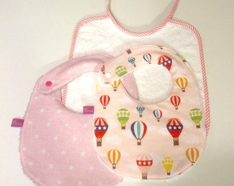 Set of three bibs printed pink
