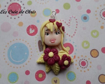 doll in polymer clay pendant.