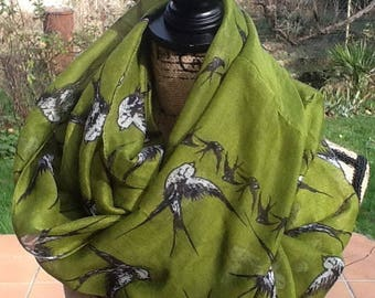 SNOOD is SEWN of VISCOSE soft green background