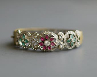 Antique Victorian hinged bangle w/ ruby, emerald, seed pearls and paste diamonds
