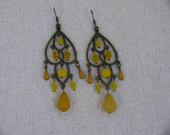 single earring with yellow beads and