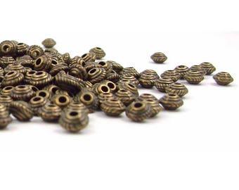 20 perles en métal 5x2mm  couleur bronze