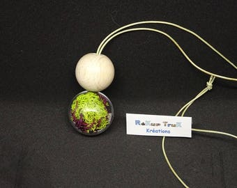 Necklace ball made of wood and transparent ball, lichen green and purple grass. Upcycling