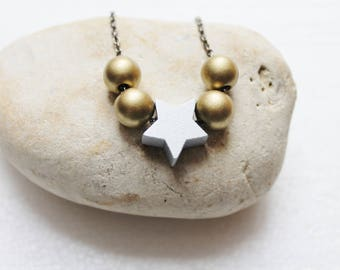 Golden Pearl Necklace and Silver Star