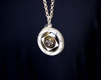 Glass crop circle pendant