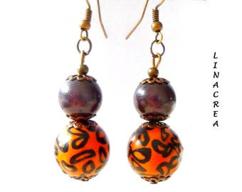 Halloween earrings Orange and black polymer clay beads and pearls magic