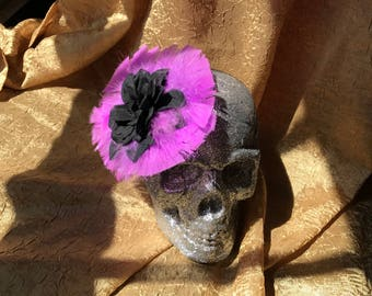Black flower and purple feathers