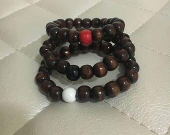 Dark wood bracelets with a pop of color!