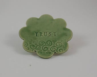Ceramic medallion: Trust
