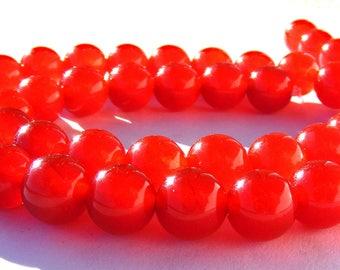 8 jades de 8mm perles pierre rouges.
