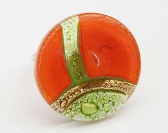 Orange and green round glass ring
