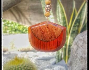 Mix of wood. POMMELE BUBINGA and COCOBOLO