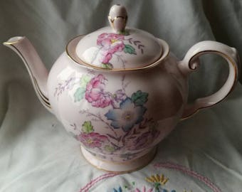 Vintage teapot. Tuscan bone china pale pink with floral pattern in purple, blue, pink and green. Made in England. Immaculate condition.