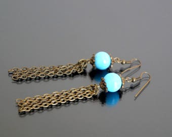 Long earrings with blue glass beads.