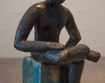 Raku sculpture, statue of a seated man