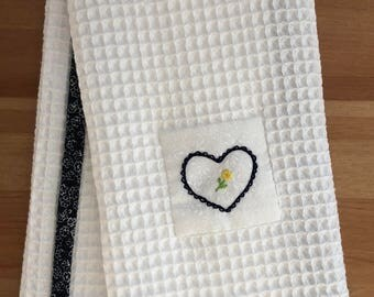 Handmade hand towel with heart-shaped stamp motif hand-embroidered by Apples N' Thyme (navy blue floral trim)