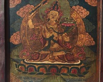 Tibetan Thangka Manjushri painting. Hand painted thangka of the Buddha of Wisdom.
