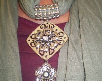 Elegant sage coloured scarf with silver coloured pendant style embellishment