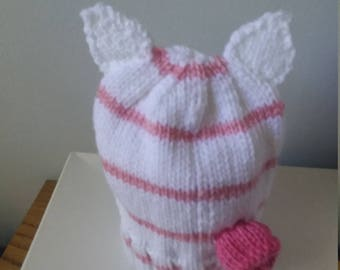 A pink striped hat with ears