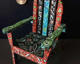 Miniature chair with ornaments