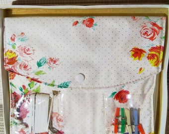 Vintage stocking holdall with miniature clothes pegs & clothes line