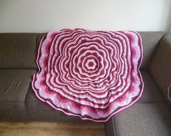 Round, crochet blanket.