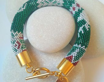 Braceled with reinder motifs