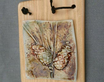 Handmade ceramic textured botanical hanging plaque./gift.
