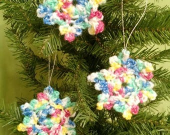 Handmade crocheted snowflake ornaments in shimmery rainbow. Set of 3