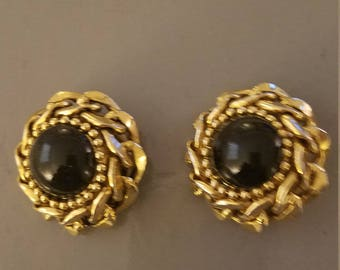 Gold braided wth black center glass stone clip on  earrings vintage 1980's