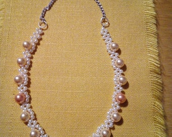 Set of necklace, earrings and bracelet